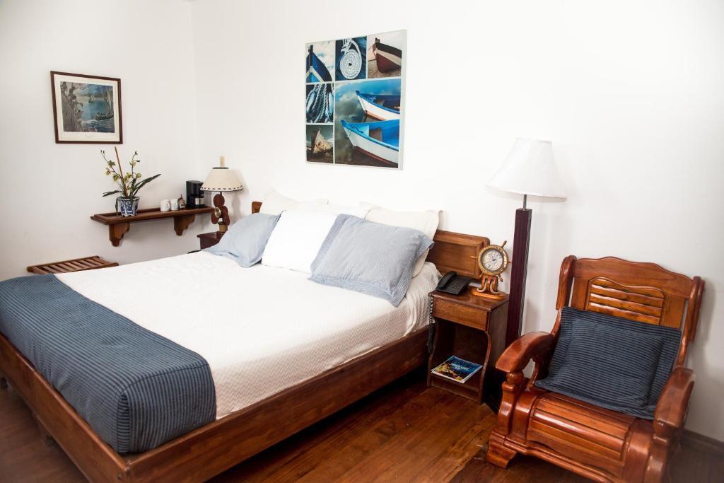 En eller flere senger på et rom på Hotel Bocas del Toro
