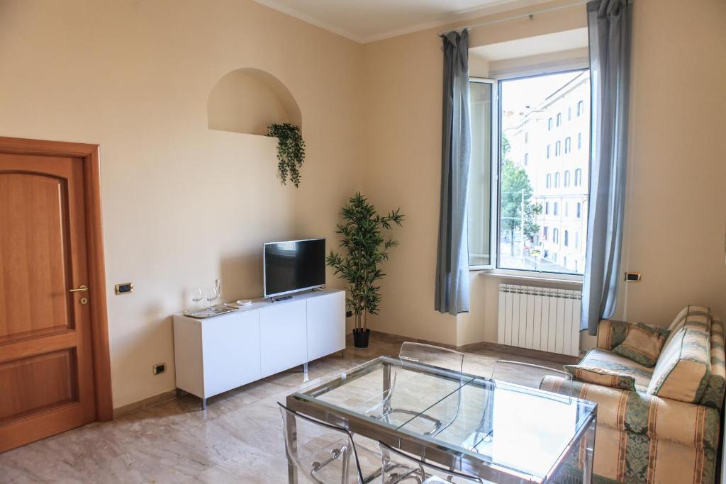 TV a/nebo společenská místnost v ubytování Colosseo Home 161