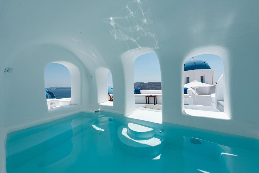 The swimming pool at or near Oia Spirit Studios