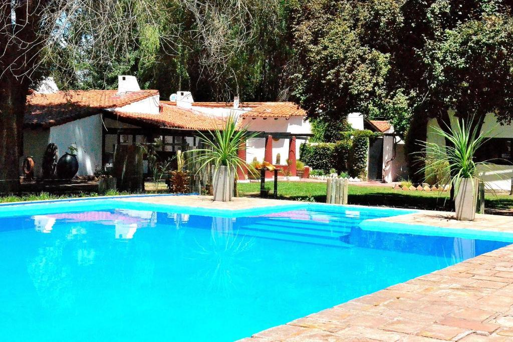 The swimming pool at or near Posada La Celia