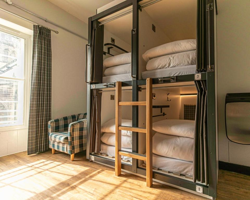 A bunk bed or bunk beds in a room at CoDE Pod Hostels - THE CoURT (Royal Mile Former Court & Jail)