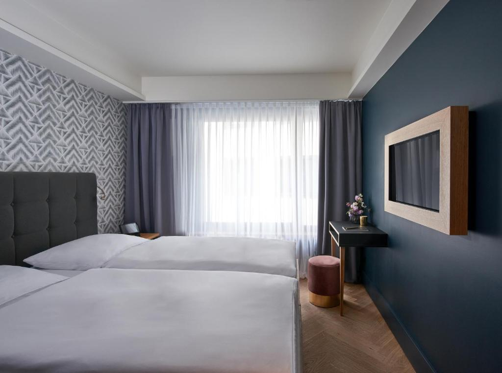 A bed or beds in a room at MIO by AMANO