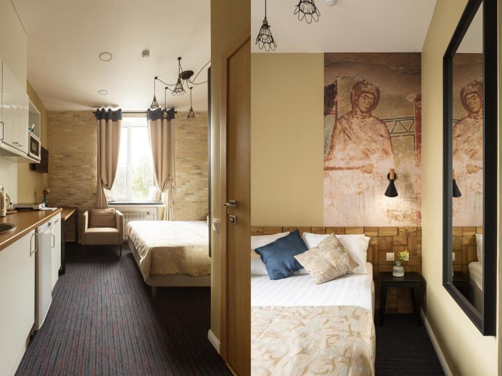Кровать или кровати в номере Отель София