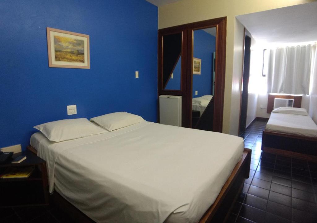A bed or beds in a room at Hotel Praia da Sereia