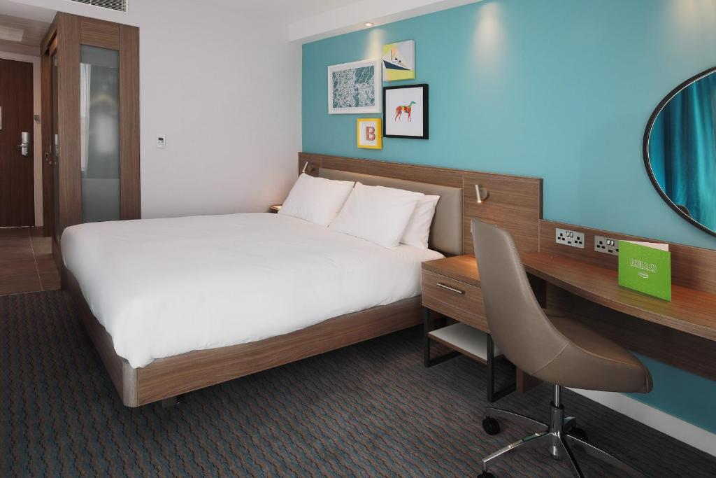 A bed or beds in a room at Hampton By Hilton Belfast City Centre