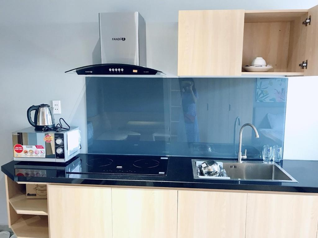 A kitchen or kitchenette at Tripporo