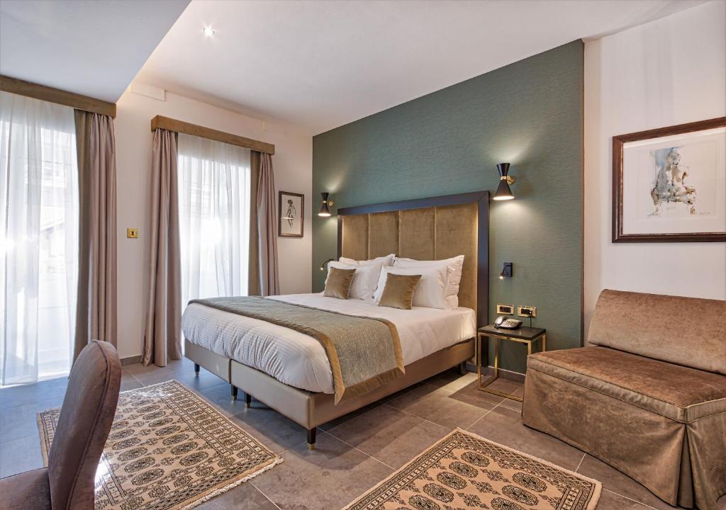 Uma cama ou camas num quarto em Palazzo Rosaria Boutique Hotel