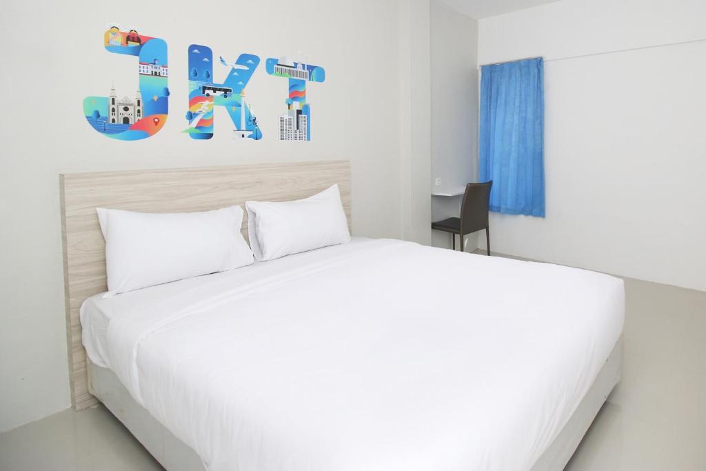 Letto o letti in una camera di Sky Residence Syariah Tanah Tinggi Tangerang