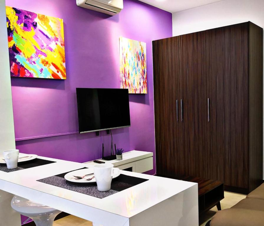 A television and/or entertainment center at Comfortzone@Malacca near Jonker, Staduys, Menara Taming Sari