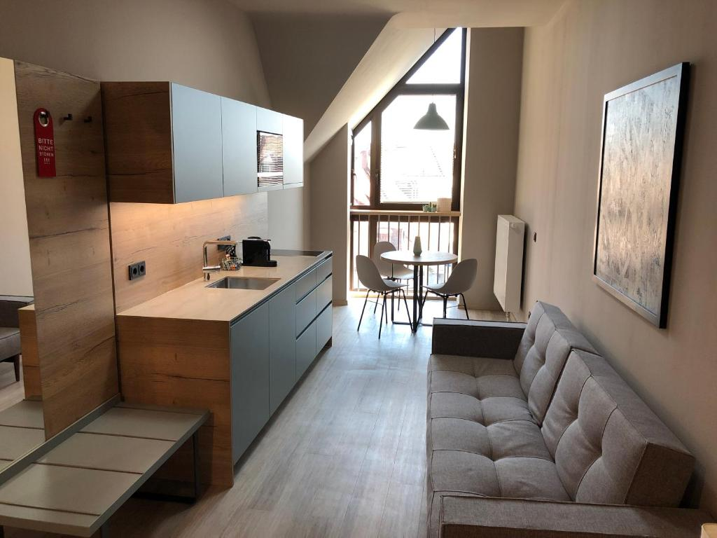 A kitchen or kitchenette at Central Studio Apartments