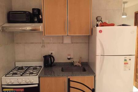 Una cocina o kitchenette en Dpto Edificio America