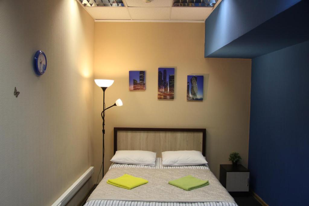 Кровать или кровати в номере Travel Inn Серпуховская