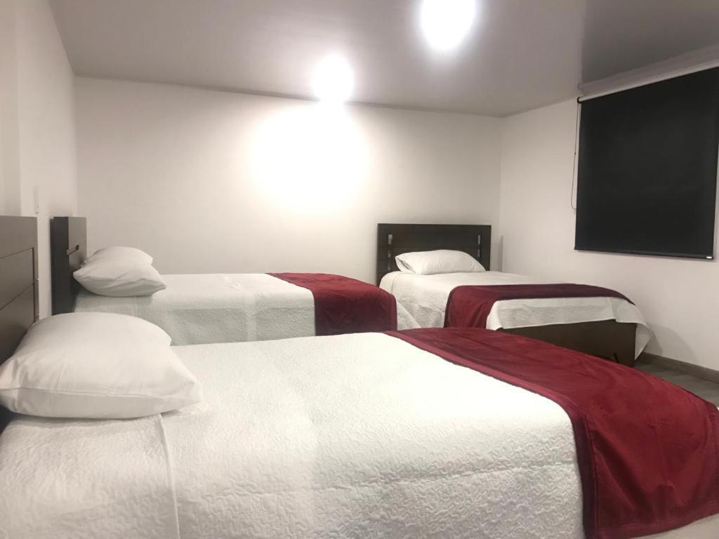 Cama ou camas em um quarto em Hotel Cristal