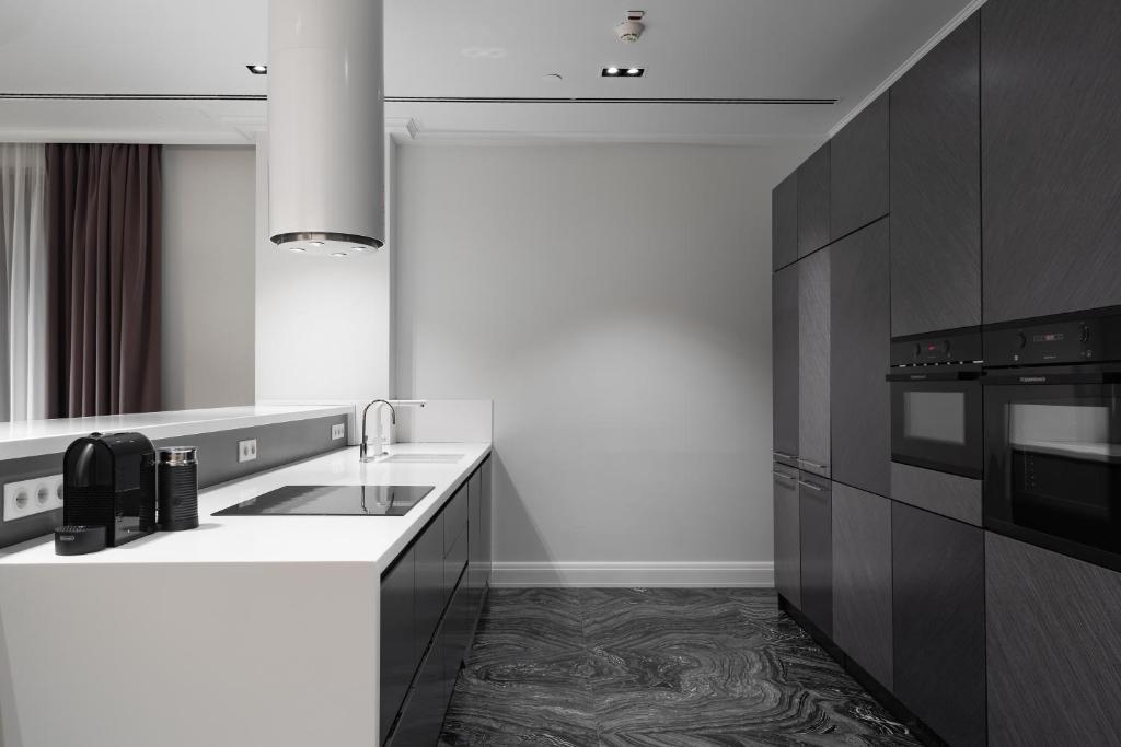 Кухня или мини-кухня в Резиденции Москва - Сервисные Апартаменты
