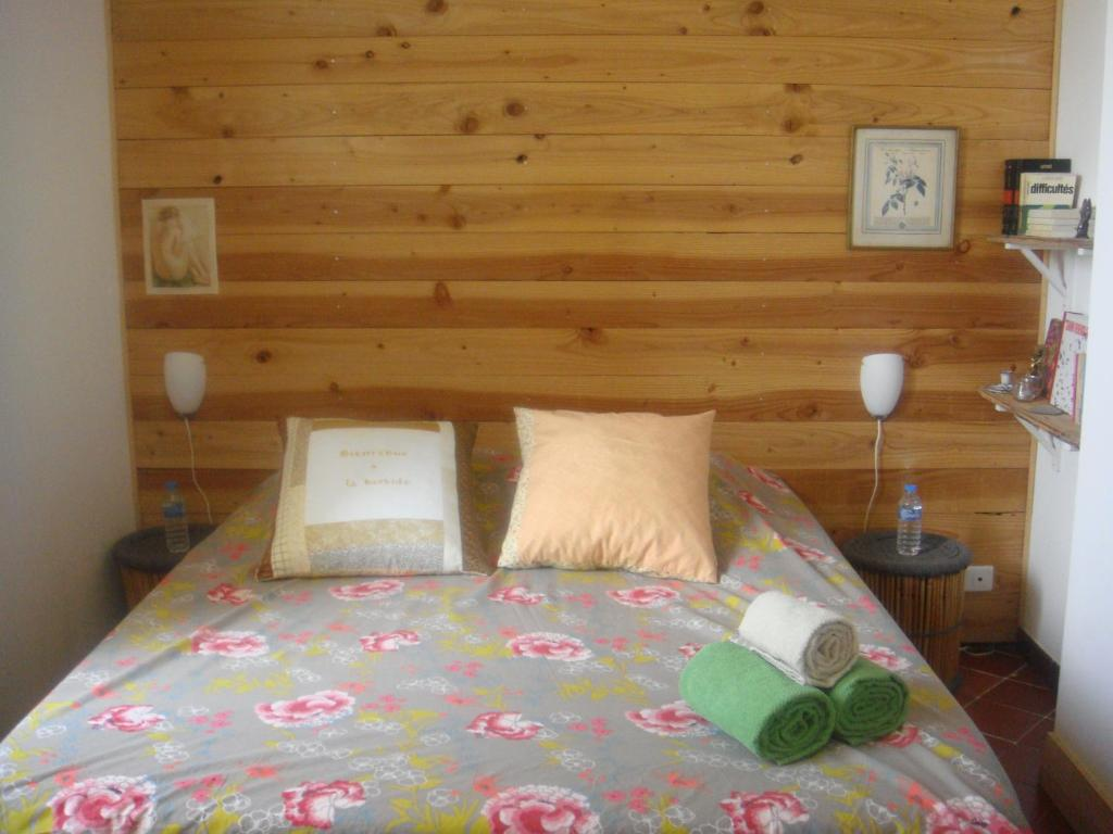 A bed or beds in a room at Bastide