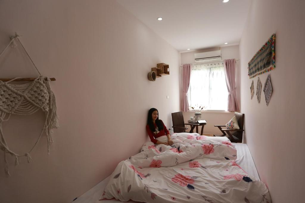 A bed or beds in a room at NEW BOUTIQUE HOMESTAY