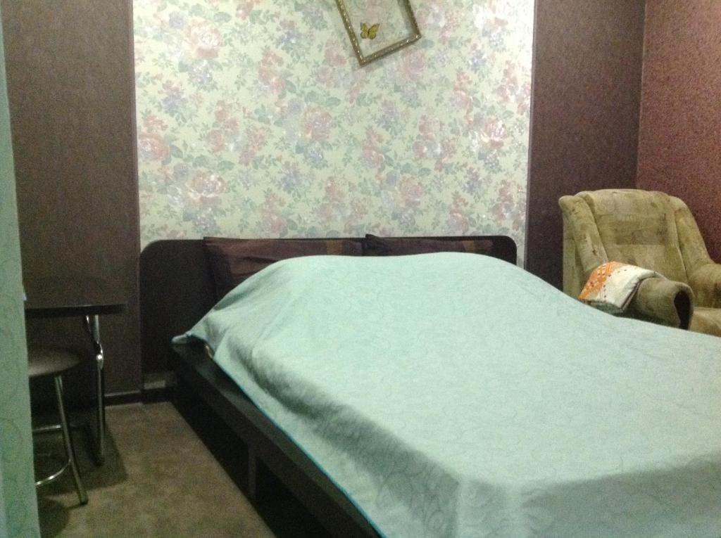 A bed or beds in a room at Hotel Na Rudneva