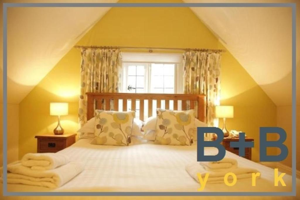 A bed or beds in a room at B+B York