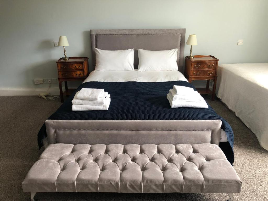 A bed or beds in a room at The Boudicca Hotel Caistor Hall