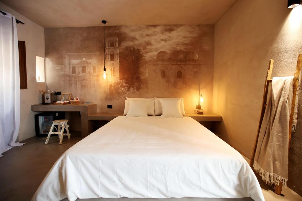 A bed or beds in a room at Casa Nostra Boutique Hotel