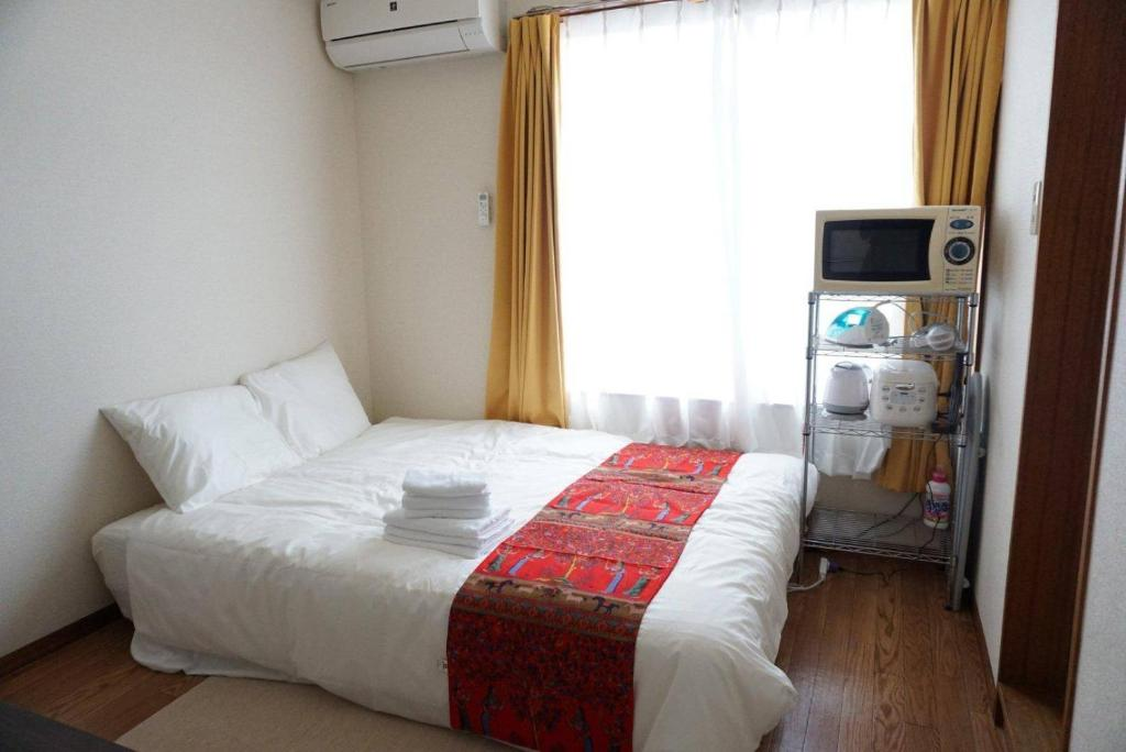 A bed or beds in a room at Apartment in Nagoya SS1B