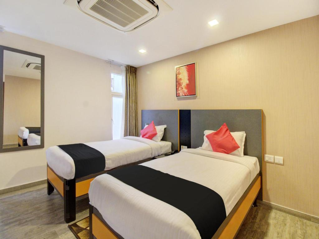 A bed or beds in a room at 37th Crescent Boutique Suites