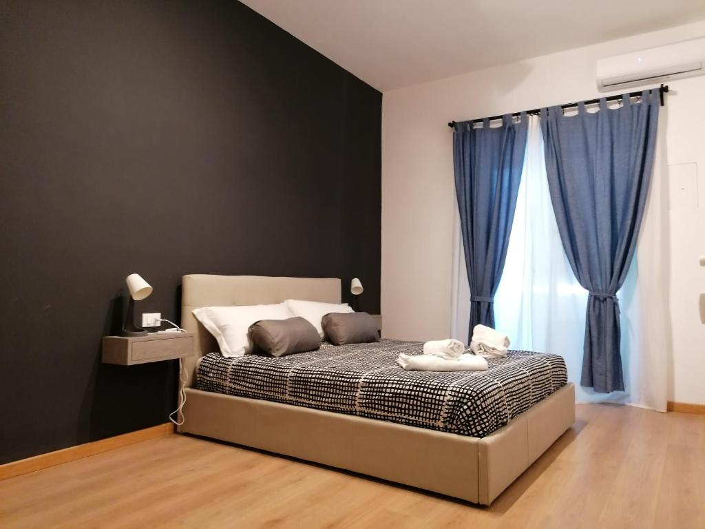 A bed or beds in a room at Chroma Italy - Doctor House