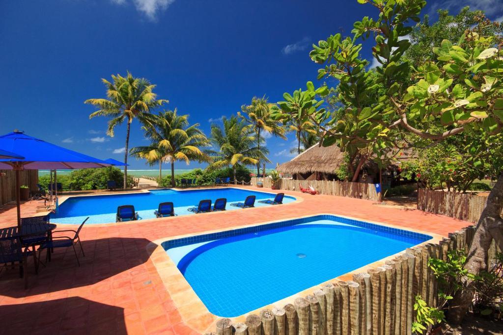 The swimming pool at or near Pousada Barra Velha