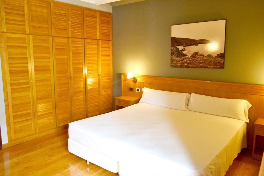 Cama o camas de una habitación en Hotel Alda El Suizo