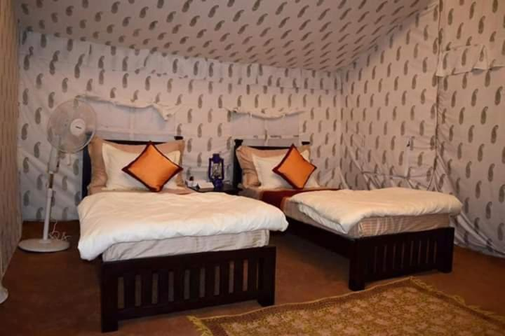 A bed or beds in a room at Desert Chandigarh camp
