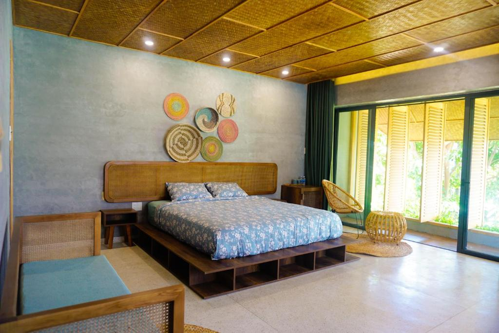 A bed or beds in a room at The AN retreat Hoi An
