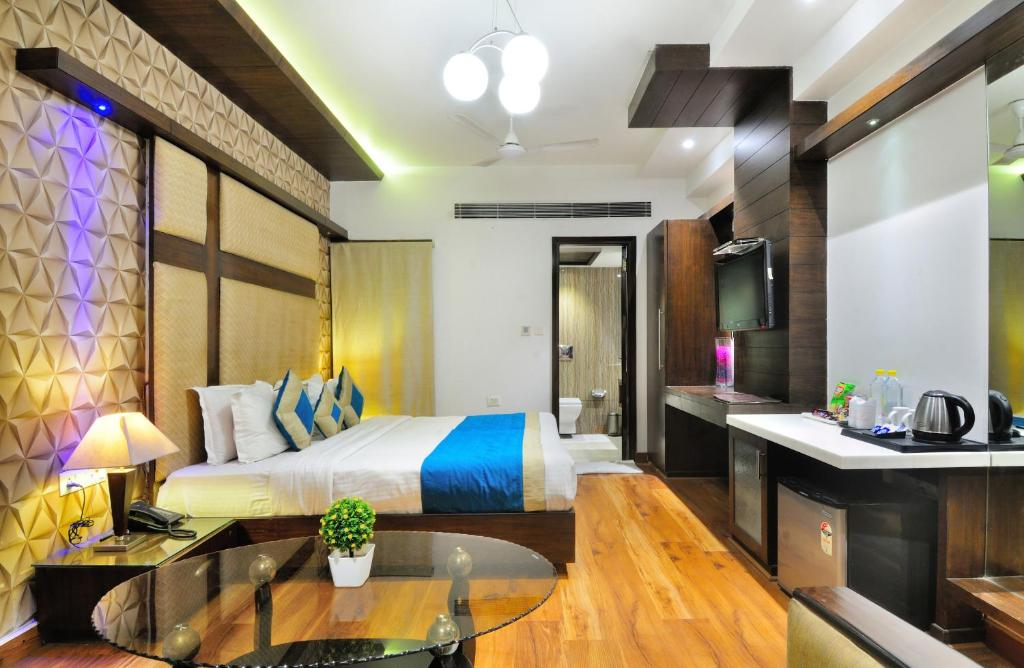 A bed or beds in a room at The Pearl Hotel
