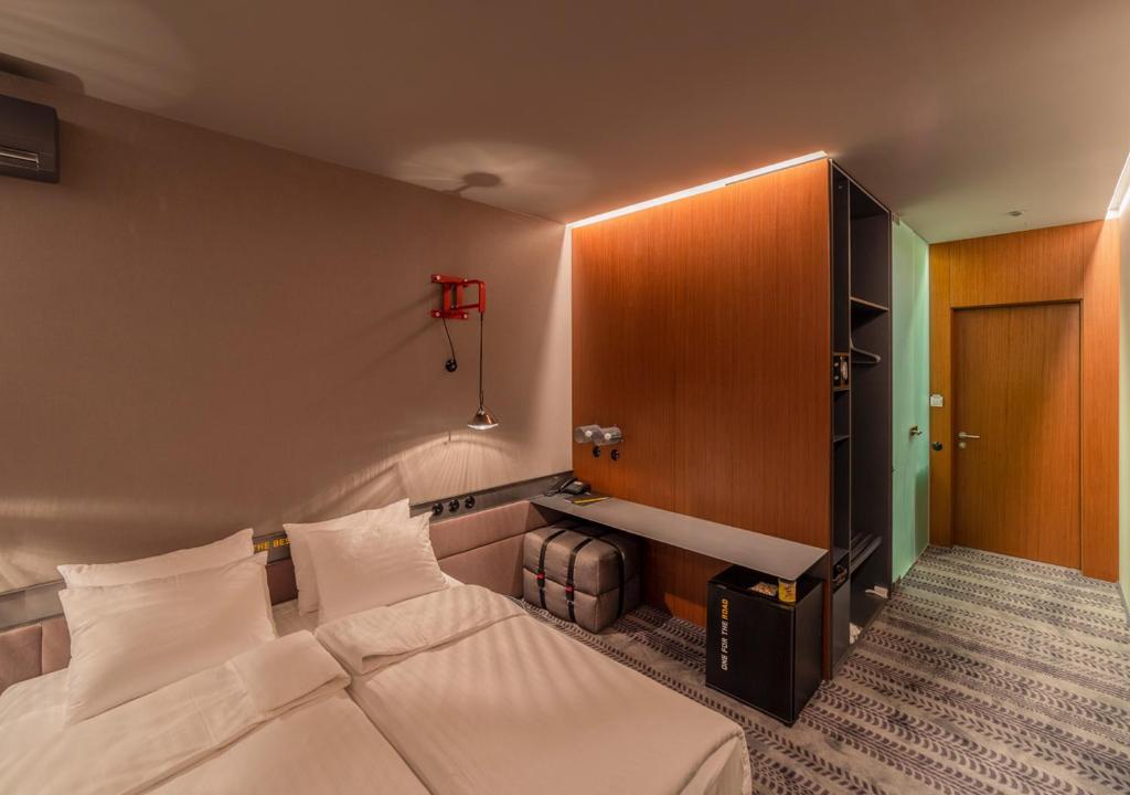 Lova arba lovos apgyvendinimo įstaigoje Design Hotel Road