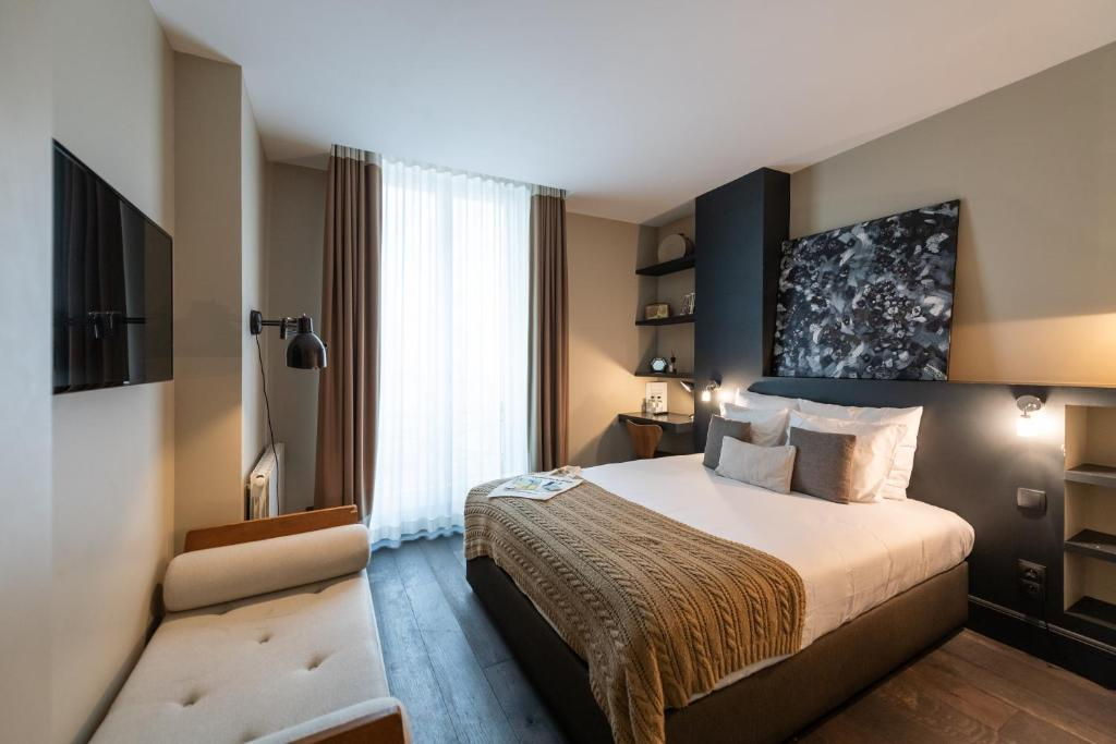 A bed or beds in a room at 1er Etage Marais