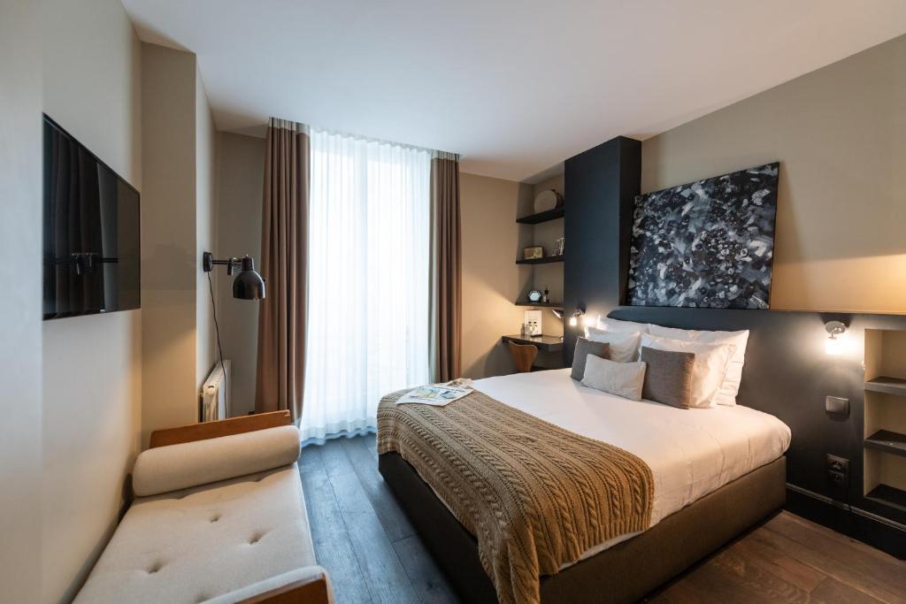 Cama ou camas em um quarto em 1er Etage Marais