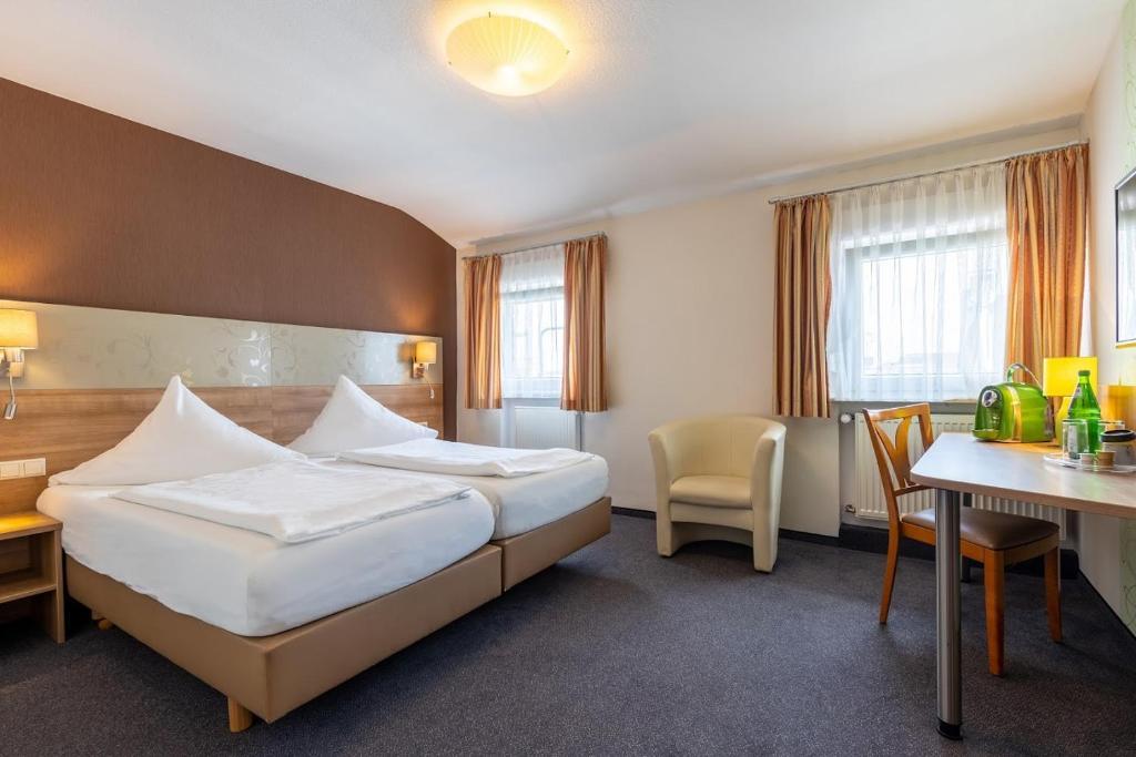 Ein Bett oder Betten in einem Zimmer der Unterkunft Trip Inn Hotel Hamm