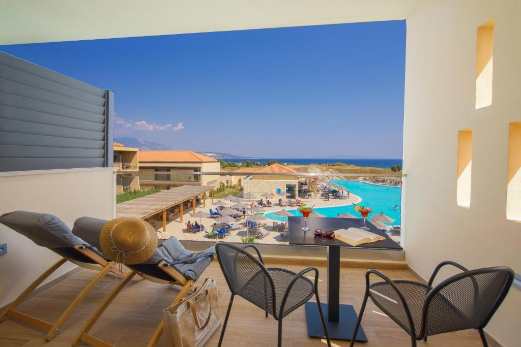 A view of the pool at Apollonion Asterias Resort and Spa or nearby