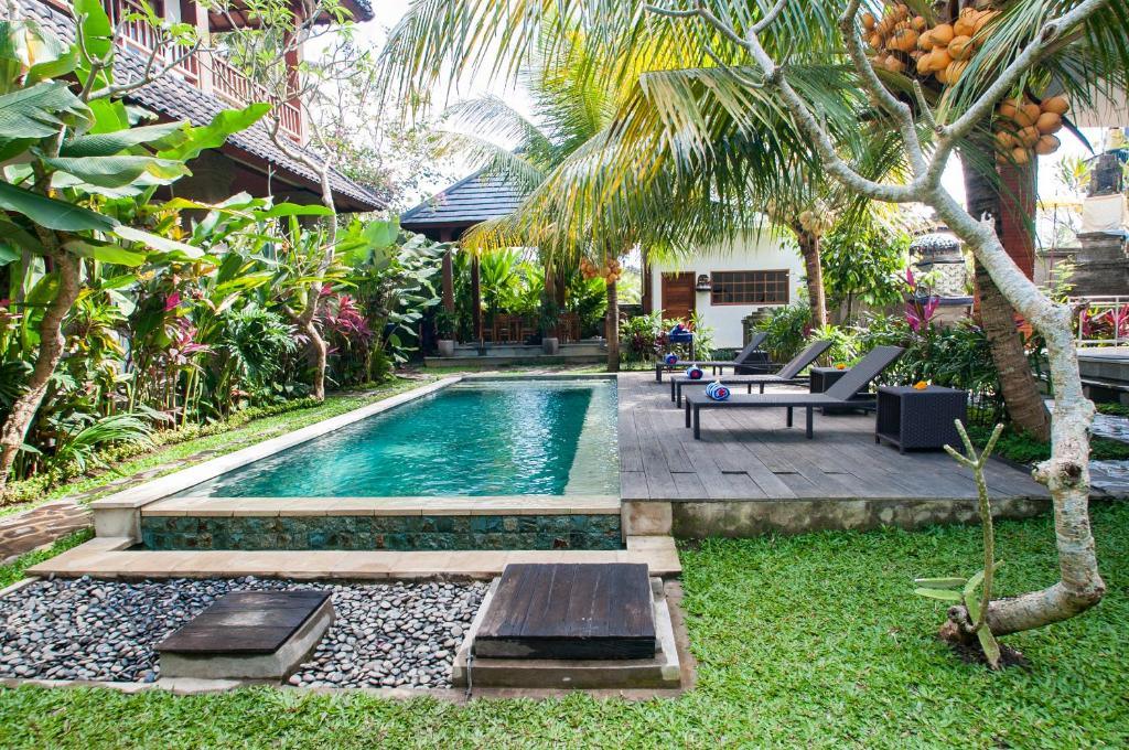 The swimming pool at or near Flamboyant Villa Ubud
