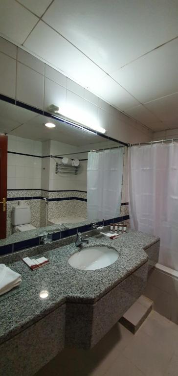 حمام في أيفوري للشقق الفندقية