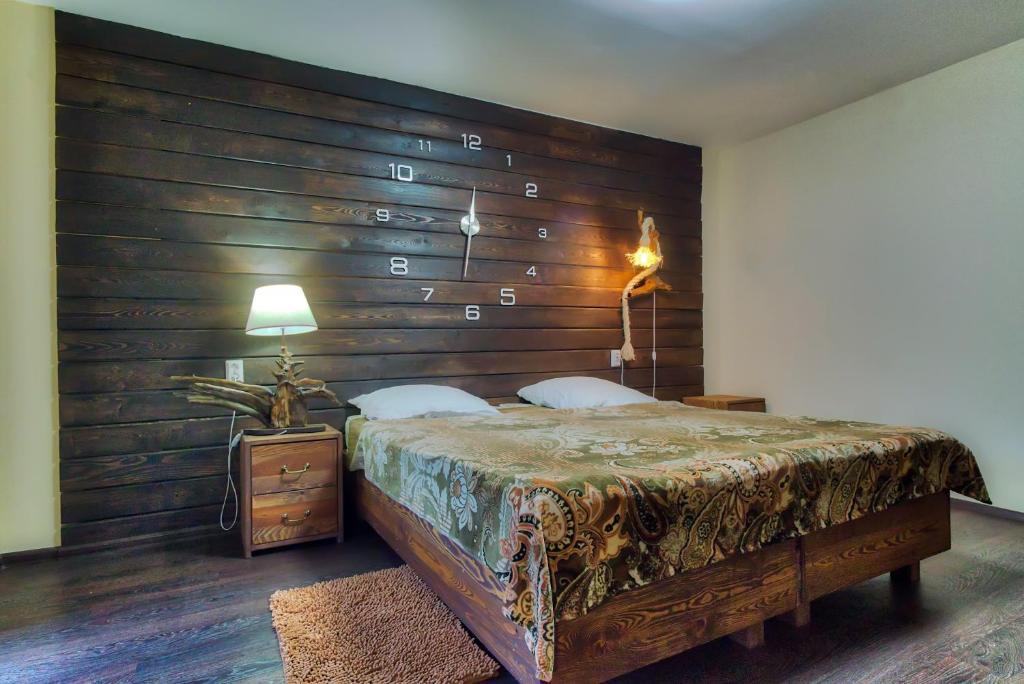 Кровать или кровати в номере Гостевой Дом Байкал Йети