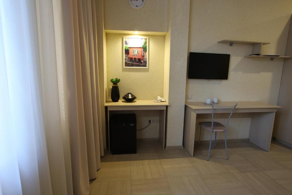 Телевизор и/или развлекательный центр в Отель Московский