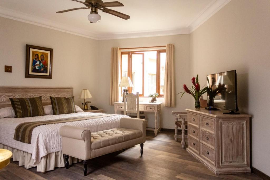 Un ou plusieurs lits dans un hébergement de l'établissement Hotel Antigua Miraflores