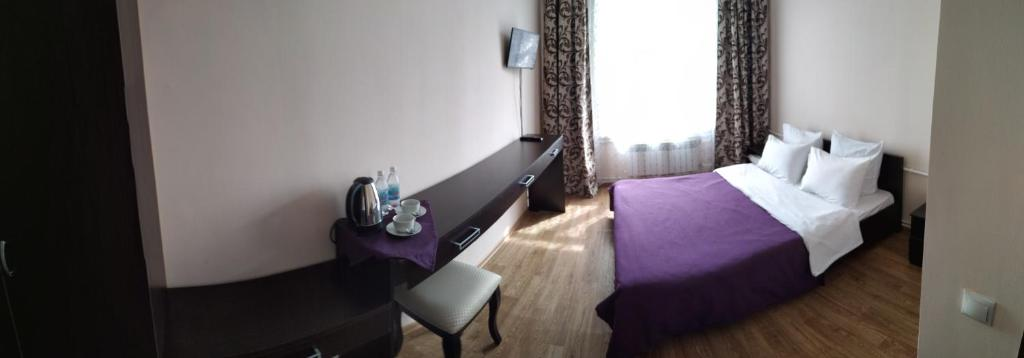 A bed or beds in a room at Hotel complex Baikalskiy Rai
