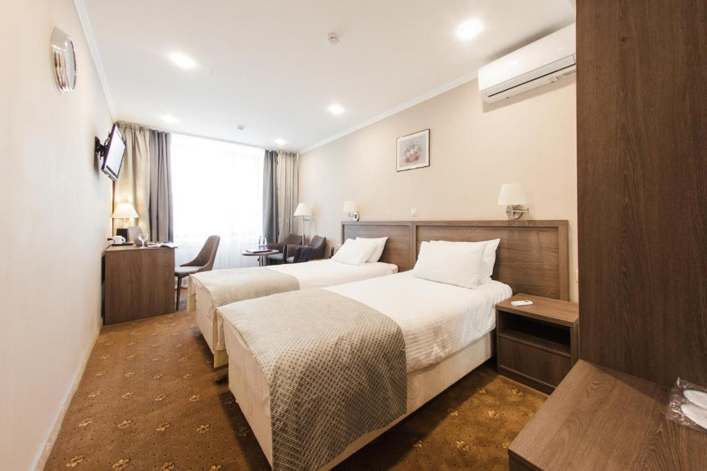 A bed or beds in a room at Baikal Business Center Hotel