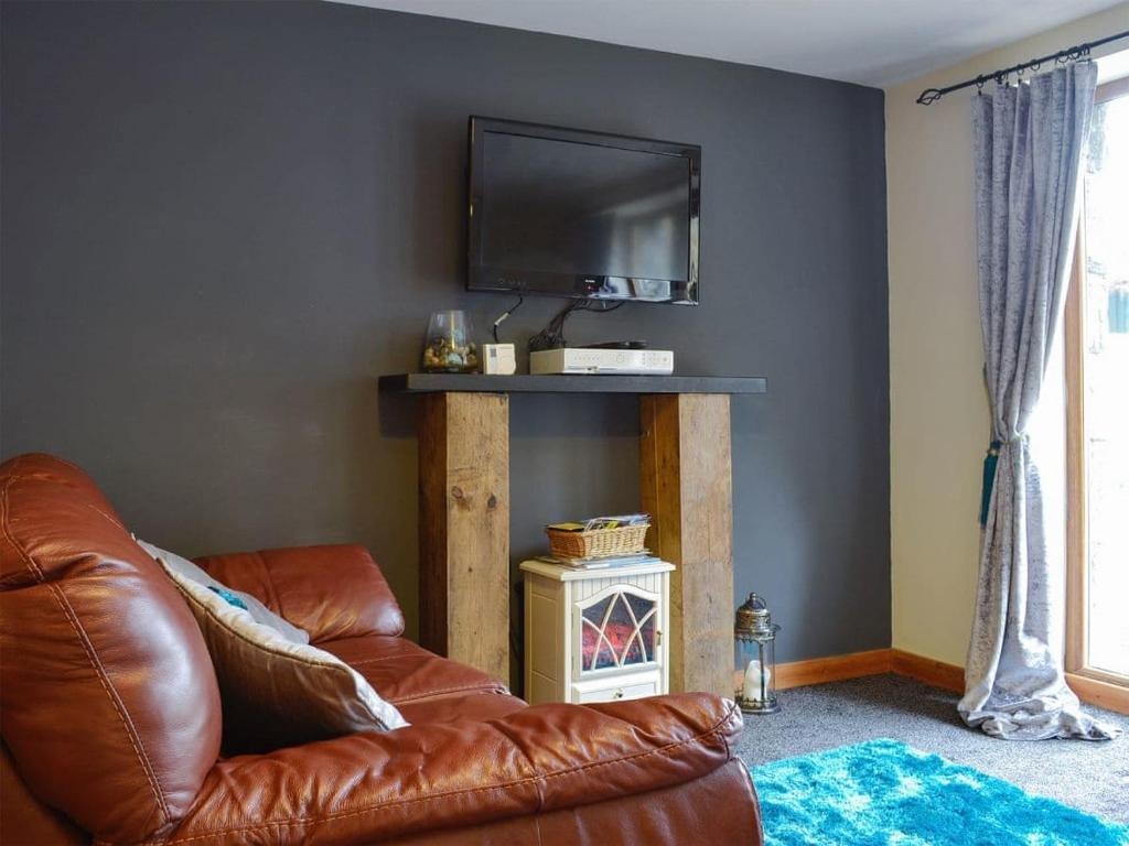 A television and/or entertainment center at Llwyn Rhedyn