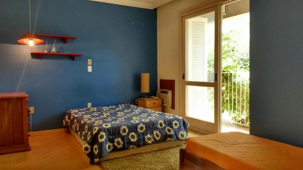 A bed or beds in a room at Casa (próx ao consulado EUA, aerop, arena), aerop, arena)
