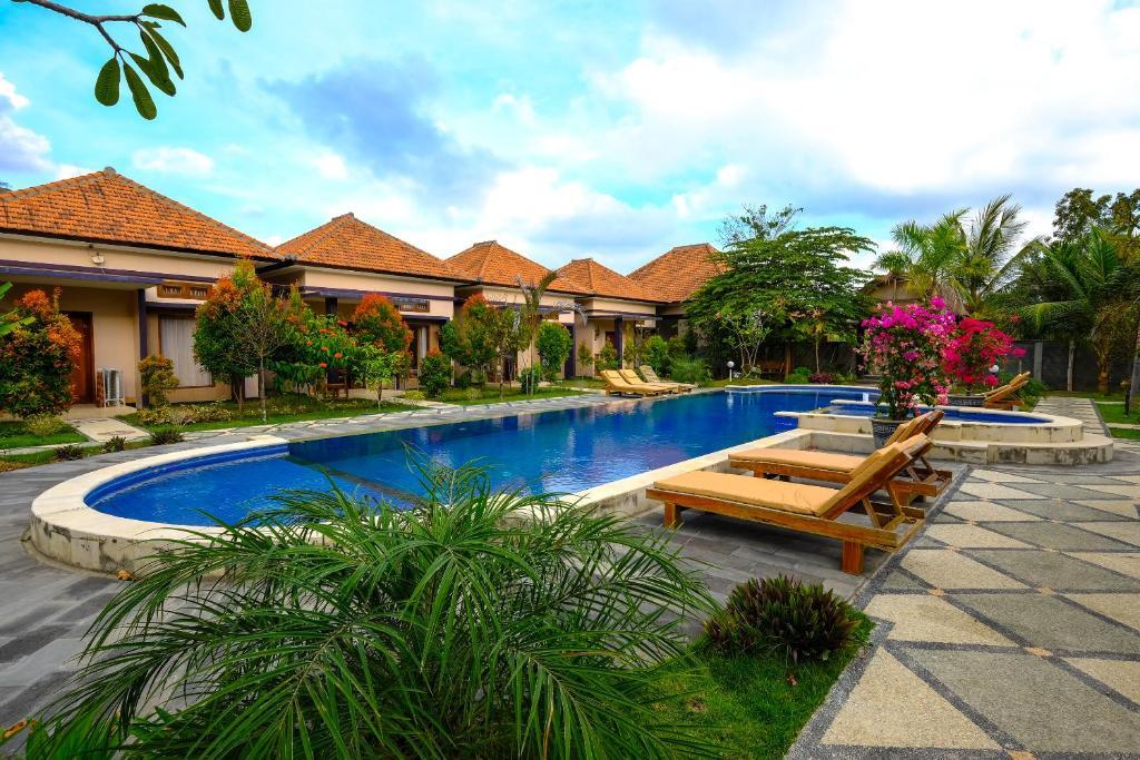 The swimming pool at or near OYO 1485 Hadiqa Villas