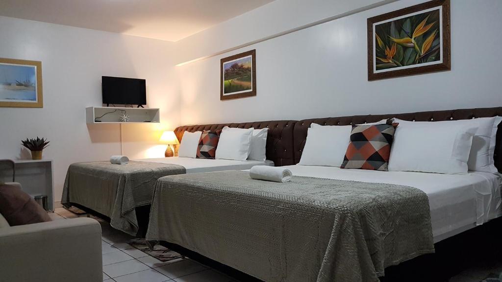 Cama ou camas em um quarto em Quarto Luxo Palladium