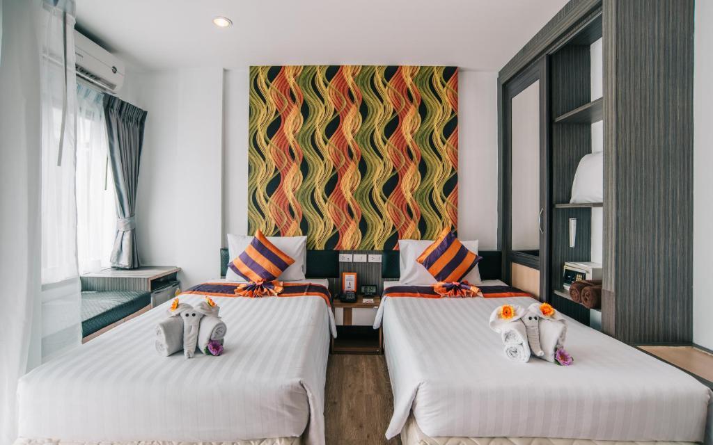 Vuode tai vuoteita majoituspaikassa Studio Patong by iCheck inn