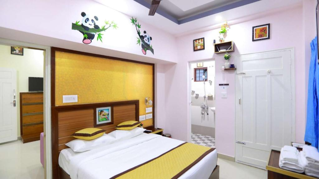 A bed or beds in a room at Base9 Airport Hotel